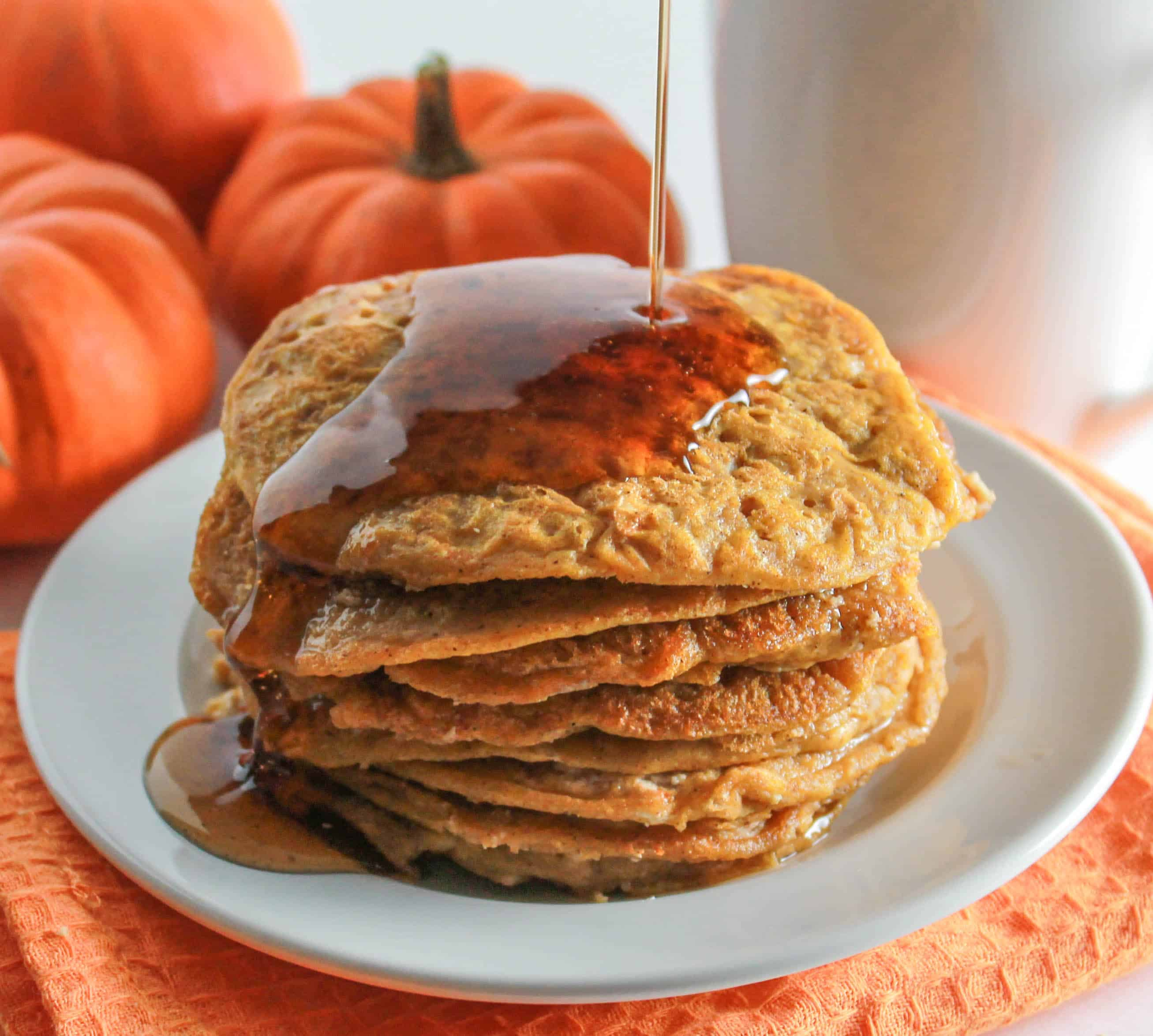 Pumpkin Cheesecake Pancakes | Destination Delish - Bits of pumpkin cheesecake packed inside fluffy pumpkin pancakes. It's the perfect autumn breakfast!