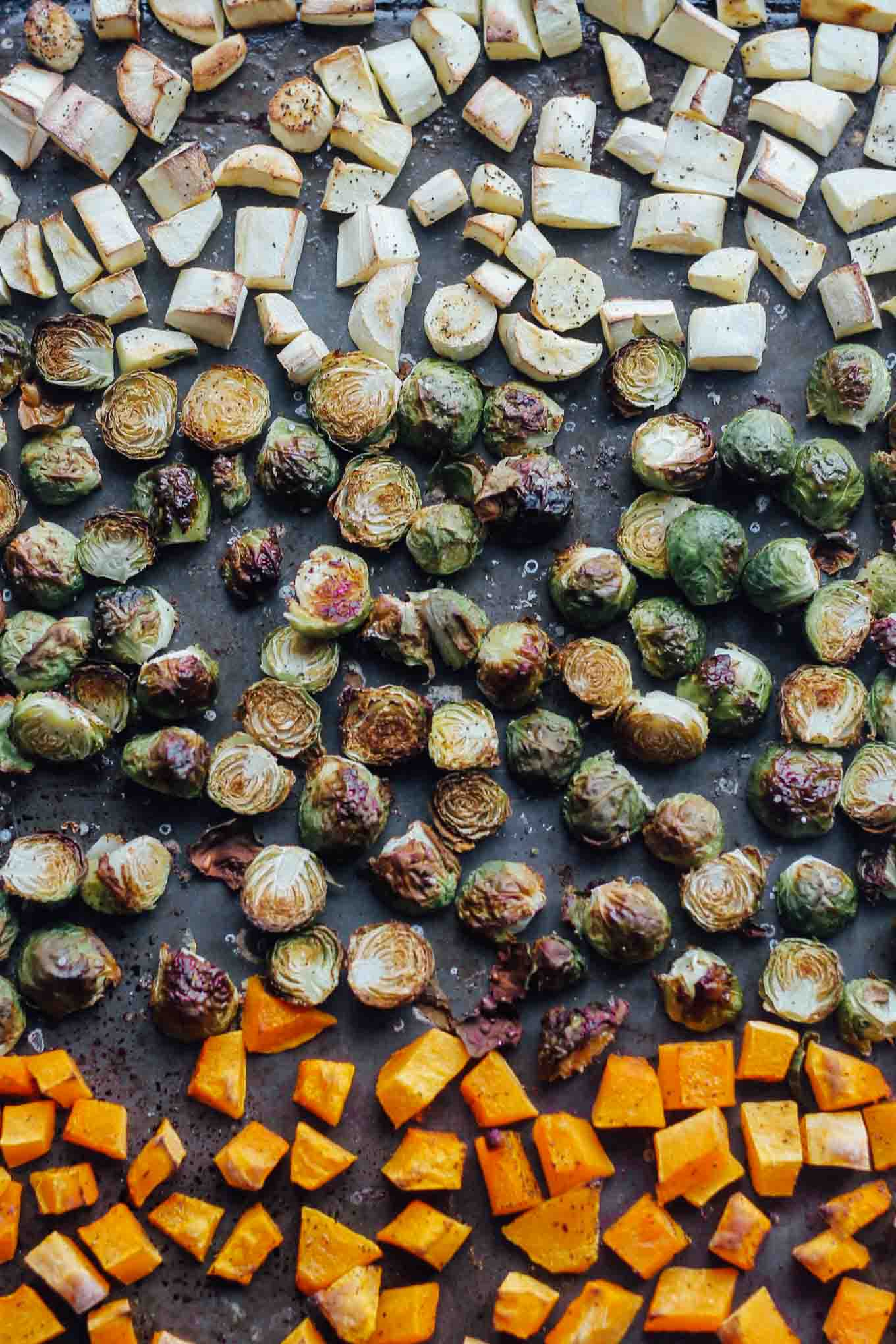 Roasted parsnips, Brussels sprouts, and butternut squash on a sheet pan