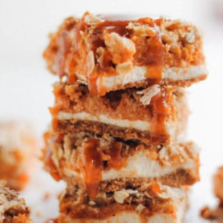 Pumpkin Pie Cheesecake Bars with Caramel Streusel | Destination Delish - A lightened up dessert combining pumpkin pie and cheesecake into one indulgent little bar.