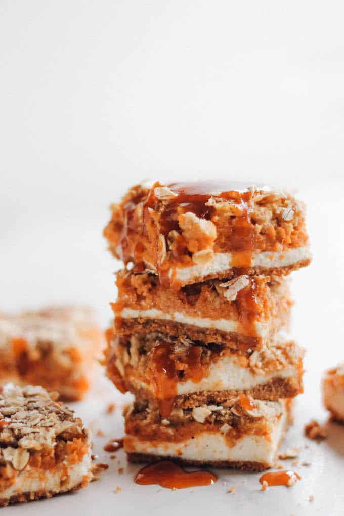 Pumpkin Pie Cheesecake Bars with Caramel Streusel | Destination Delish - A lightened up dessert combining pumpkin pie and cheesecake into one indulgent little bar.