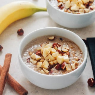 Banana Hazelnut Breakfast Quinoa   Destination Delish - Cozy up to a bowl of this wholesome breakfast quinoa with chopped hazelnuts and bananas and sweetened with maple syrup.