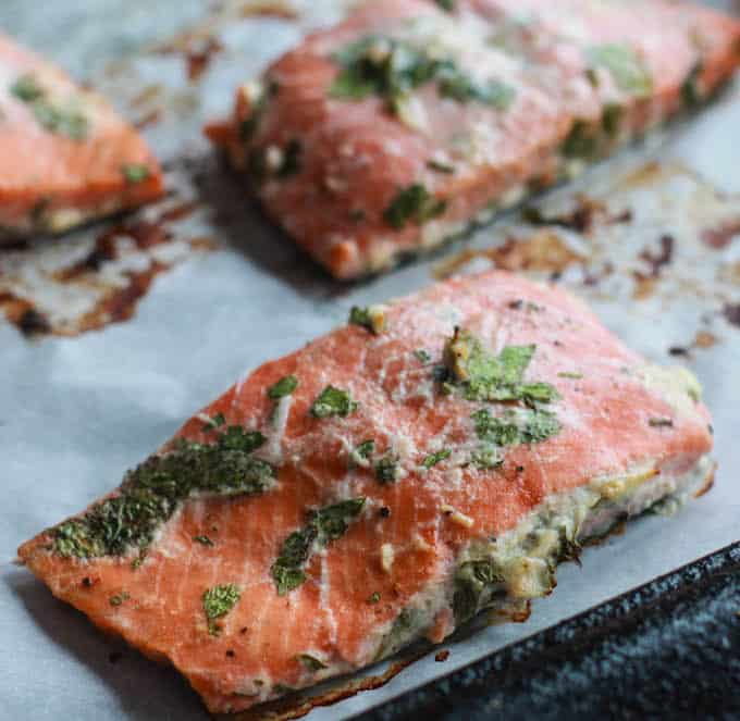 Cilantro Lime Baked Salmon with Chipotle Cashew Cream | Destination Delish - Zesty salmon baked until tender and flaky and topped with a creamy and spicy cashew sauce