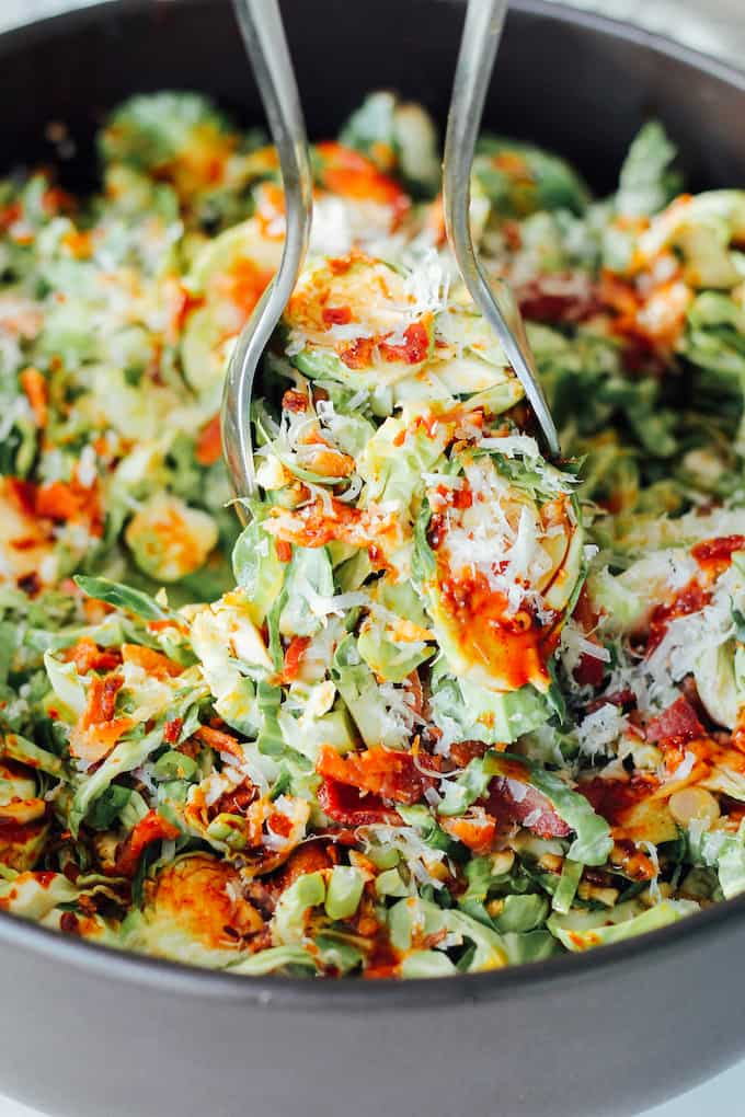 Kimchi Brussels Sprout Salad | Destination Delish - This salad combines shredded sprouts with a simple dressing using kimchi-inspired flavors so you get all that spicy, sour, tangy goodness in less time!