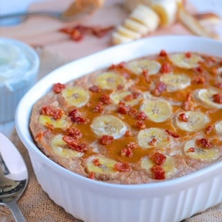 Peanut Butter, Banana, and Bacon Baked Oatmeal | Destination Delish - an Elvis inspired breakfast recipe. Sweet bananas, smooth peanut butter, and crispy bits of salty bacon combined into a hearty and creamy baked oatmeal