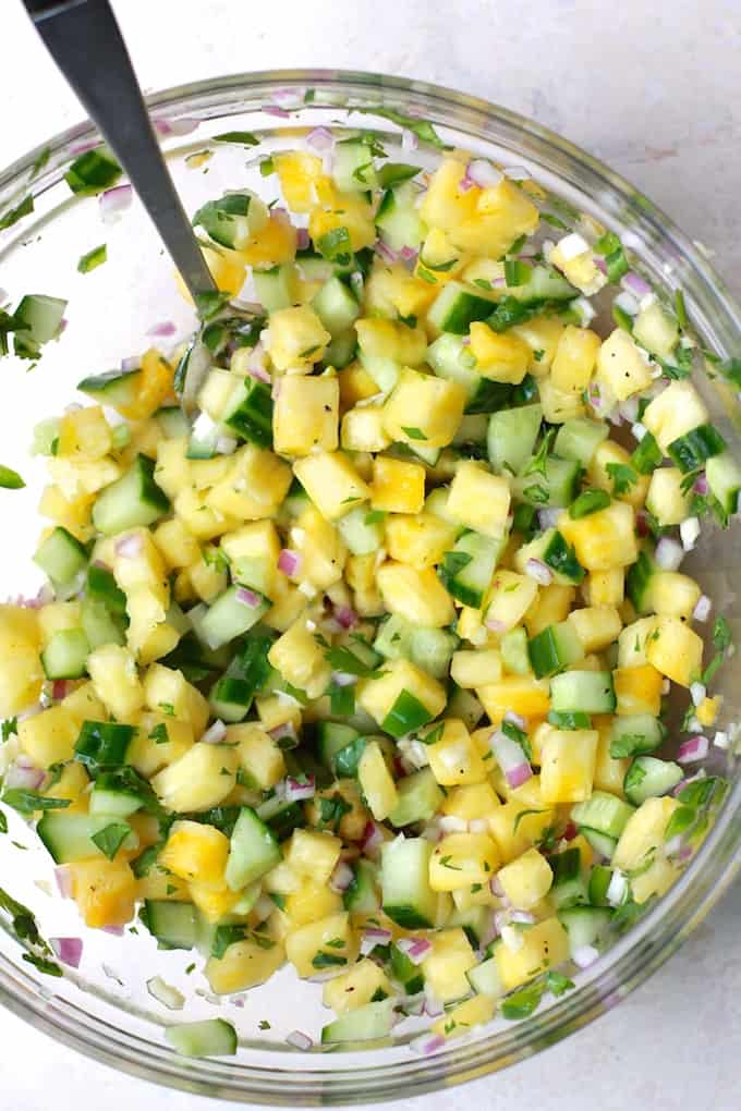 Pineapple Cucumber Salsa | Destination Delish - The perfect summer salsa featuring a sweet and juicy kick from the fresh pineapple and a refreshing crunch from the cucumber. Vegan, gluten free, and healthy!