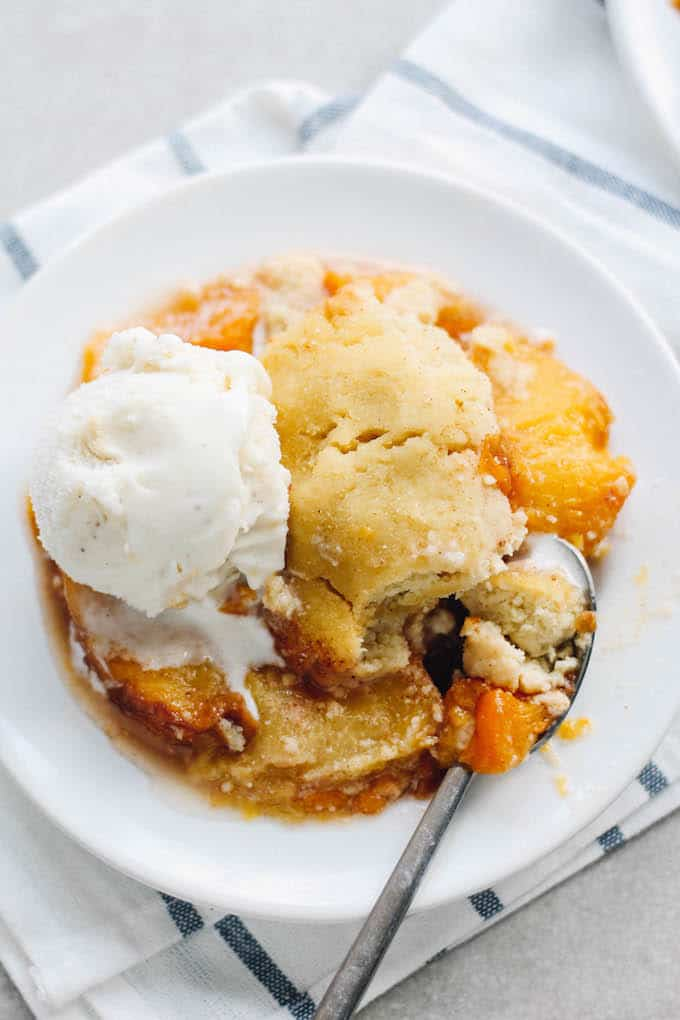 Coconut Peach Cobbler | Destination Delish - A gluten-free, paleo version of the classic peach cobbler yielding a cake-like texture with a warm peach compote.