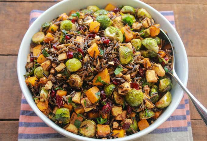 Butternut Squash, Brussels Sprouts, and Parsnip Toss with Wild Rice, Cranberries, and Feta | Destination Delish