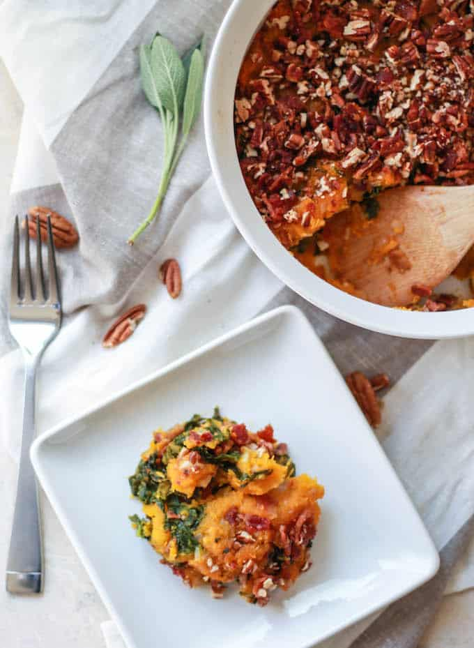 Butternut Squash, Bacon, and Kale Casserole | Destination Delish - a sweet and savory Thanksgiving side dish filled with kale and topped with crunchy pecans and bacon
