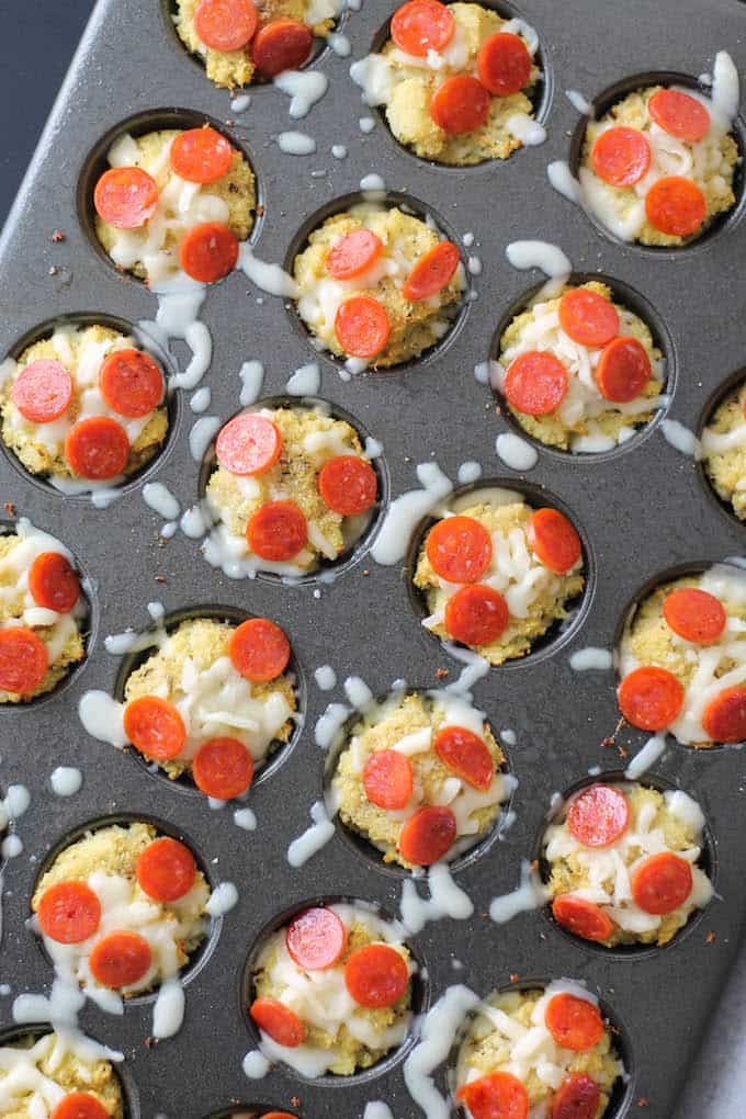 Cauliflower Pizza Bites | Destination Delish - Cauliflower crust pizza made into mini bites with a cheesy surprise in the middle