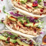 Korean Pulled Chicken Tacos | Destination Delish - Korean-inspired tacos filled with tender pulled chicken, kimchi, and lettuce. It's a quick and healthy dinner the whole family will love!