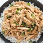Slow Cooker Korean Pulled Chicken | Destination Delish – an easy recipe for tender chicken cooked in a sweet and savory mixture of garlic, ginger, and soy sauce