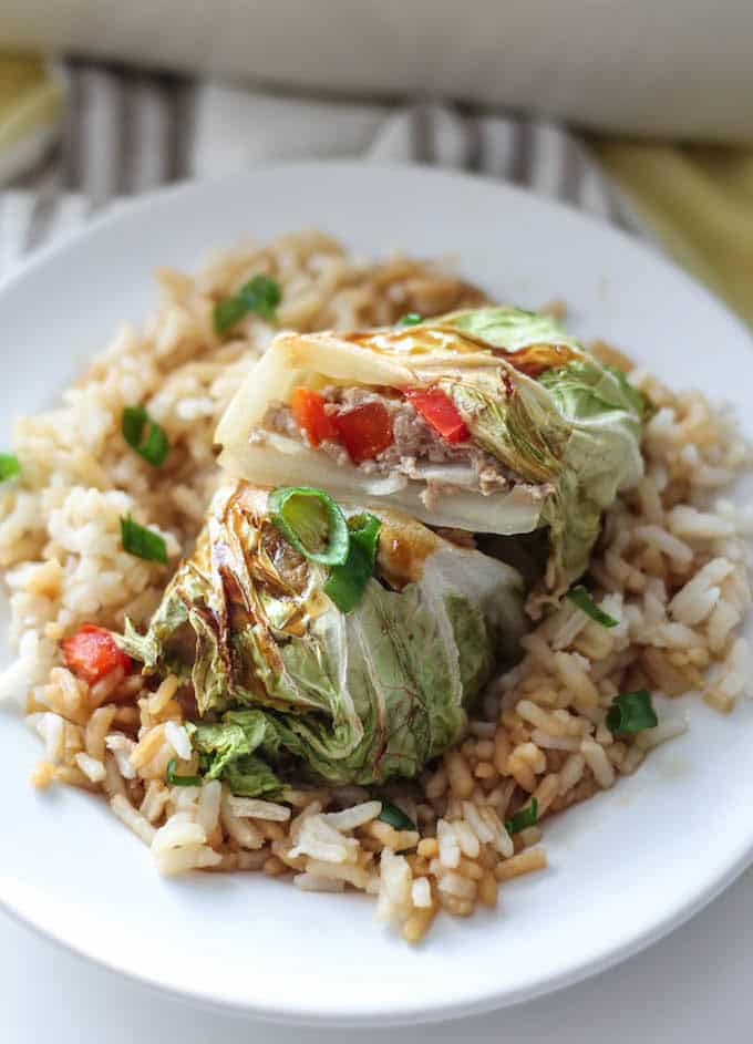Teriyaki Turkey Cabbage Rolls - A quick and easy Asian-inspired recipe. These healthy cabbage rolls are stuffed with sweet pineapple, chopped veggies, and ground turkey. It's a wholesome meal perfect for busy weeknights!