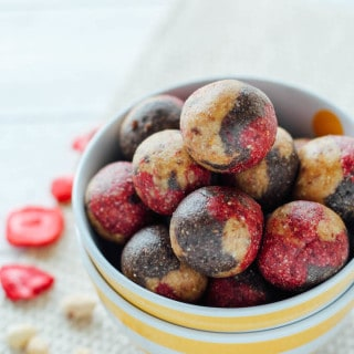 Banana Split Energy Balls | Destination Delish – an all-natural snack combining strawberry, banana, and chocolate flavors with cashews, dates, and almond milk