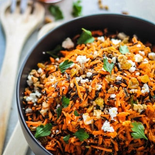 Shredded Carrot and Wild Rice Salad | Destination Delish – a vibrant blend of carrots, wild rice, feta, raisins, and walnuts tossed in a tangy harissa dressing