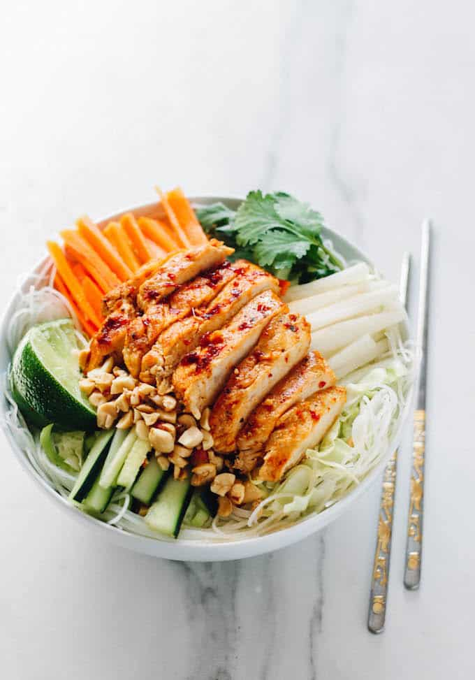 Sweet Chili Glazed Chicken Rice Noodle Bowls | Destination Delish – A healthy rice noodle salad with tangy chicken, zesty veggies, tender rice noodles, and crunchy chopped peanuts