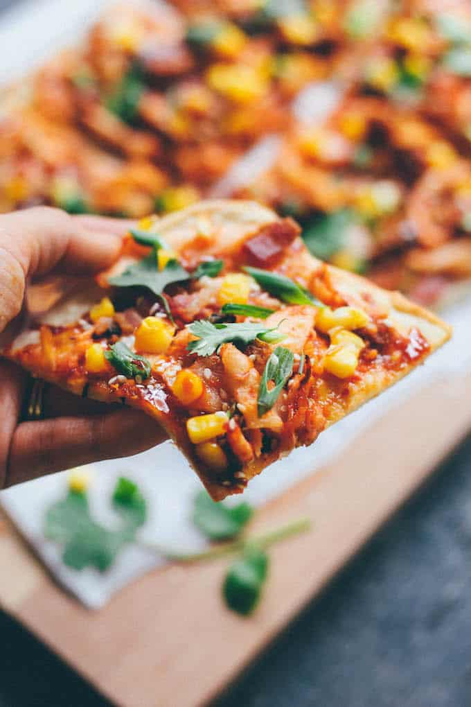 Kimchi, Bacon, and Corn Pizza | Destination Delish - A flatbread pizza bursting with flavor! Topped with kimchi, salty bacon, sweet corn, and Korean BBQ sauce, this is one unforgettable pizza.