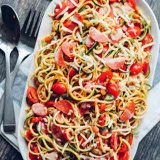 Spiralized Spaghetti Salad | Destination Delish – a zesty summer potluck favorite made healthy with zucchini noodles, turkey pepperoni, and plenty of chopped veggies.