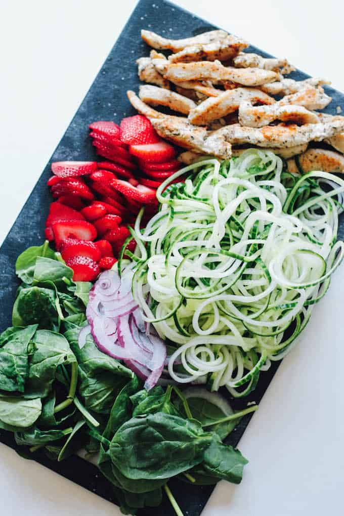 Strawberry Poppyseed and Cucumber Noodle Spring Rolls | Destination Delish – sweet strawberries, tender chicken, cucumber noodles, and spinach all rolled up into a fresh spring roll with dressing to dip on the side. It's a light and refreshing appetizer to enjoy on those hot summer days!