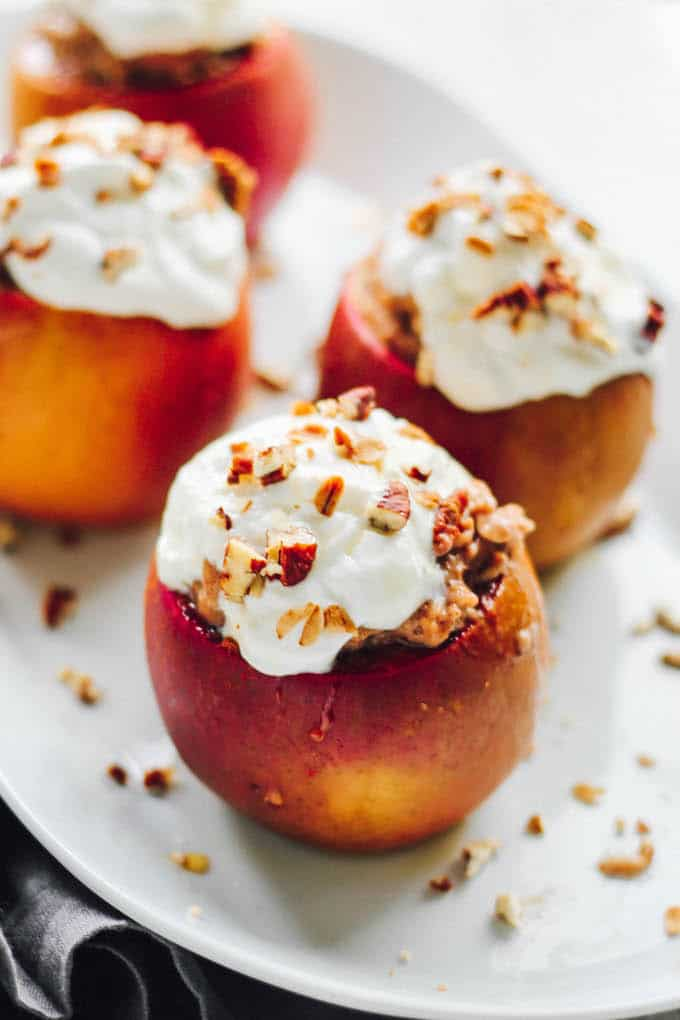 Baked Apples with Cinnamon Spice Oatmeal | Destination Delish - sweet and tender baked apples stuffed with creamy cinnamon spiced oatmeal. It's a cozy breakfast that will warm you up on a chilly morning!
