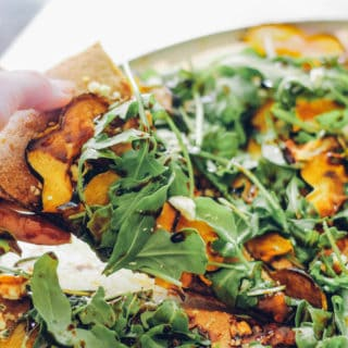 Acorn Squash Arugula Pizza - Toppings include roasted acorn squash, feta cheese, arugula, and a drizzle of balsamic. A healthy option for pizza night!