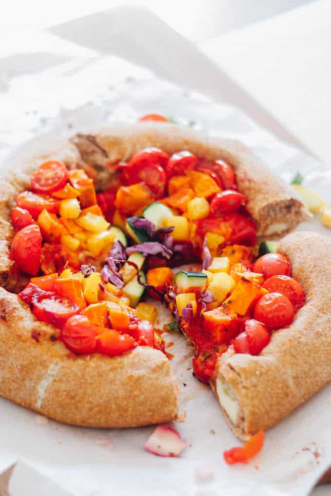 Stuffed Crust Veggie Pizzas | Destination Delish - wholesome, colorful veggies atop a whole wheat pizza crust stuffed with gooey cheese. Perfect for pizza nights!