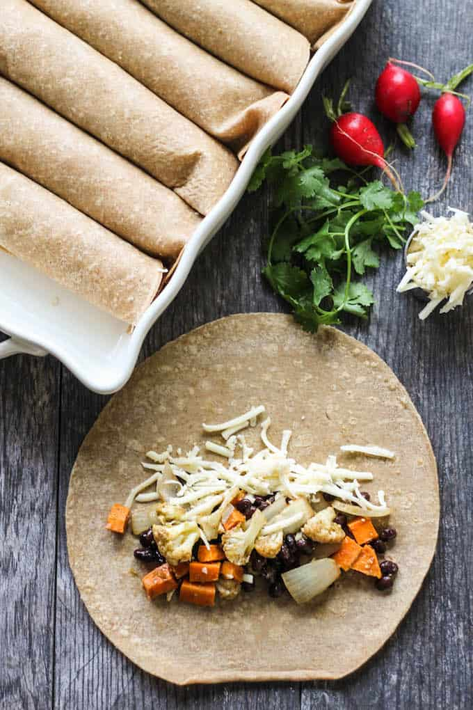 Cauliflower Sweet Potato Enchiladas | Destination Delish - hearty vegetarian enchiladas that are easy to make and full of healthy vegetables. It's a wholesome and comforting dish perfect for cold winter months!