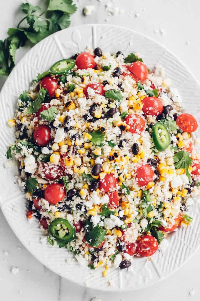 Fiesta Cauliflower Rice Salad | Destination Delish - a fluffy cauliflower rice salad packed with colorful veggies and tossed in a tangy citrus dressing. Enjoy this as a healthy side dish or light lunch!