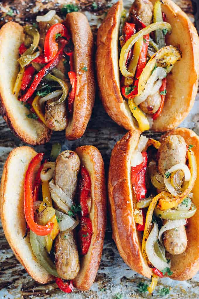 Sheet Pan Sausage and Pepper Hoagies | Destination Delish - sweet peppers, caramelized onions, and chicken sausage tucked inside a toasted bun. Sheet pan dinner perfection!
