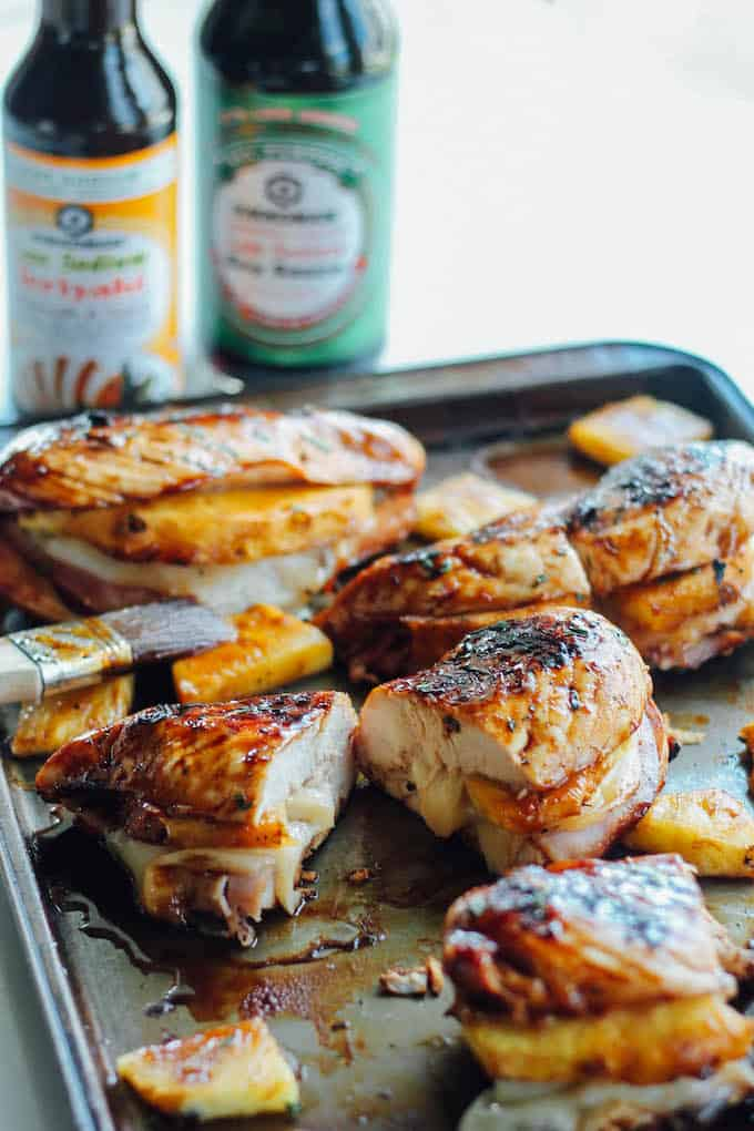Grilled Hawaiian Stuffed Chicken | Destination Delish - grilled chicken breasts brushed with a pineapple teriyaki glaze and stuffed with ham, pineapple, and provolone cheese. Summer grilling perfection!