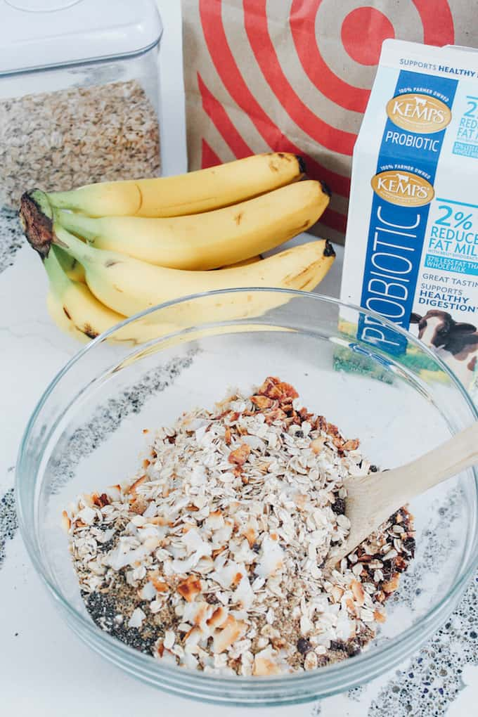 Toasted Coconut, Banana, and Chocolate Muesli | Destination Delish - A cozy oats breakfast that can be served warm or cold! Top with extra chocolate shavings and banana slices for a wholesome and healthy morning treat!