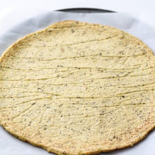 Cauliflower Pizza Crust | Destination Delish - Pile your favorite toppings on this super easy paleo Cauliflower Pizza Crust! Cauliflower, eggs, salt, and pepper are all you need to make this healthy and tasty pizza crust!