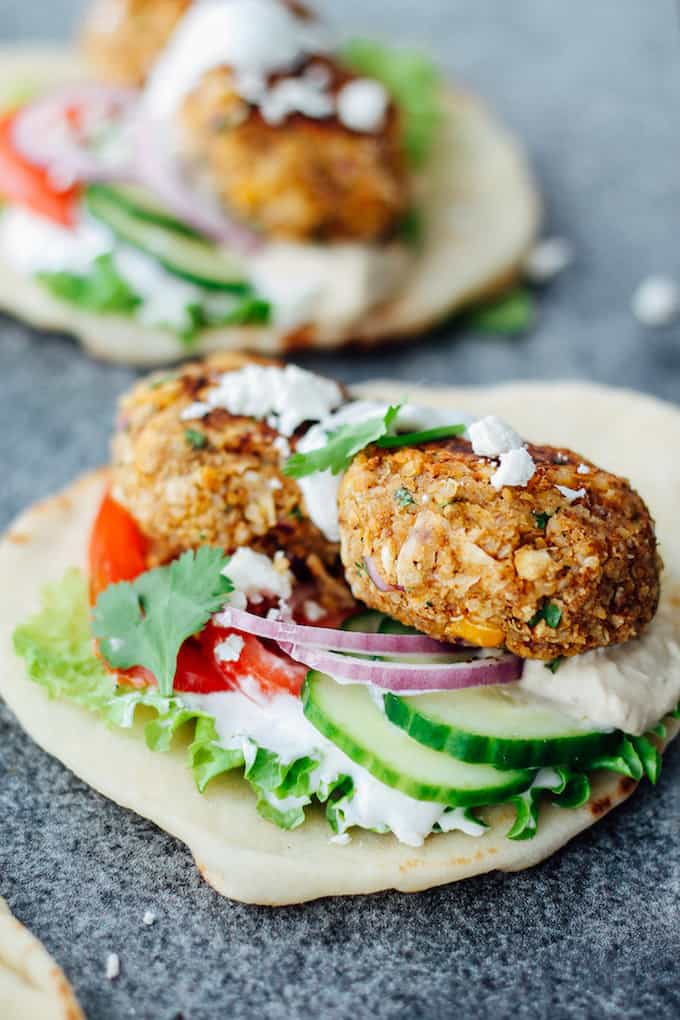 Mini Veggie Burger Naan Wraps | Destination Delish - The perfect warm weather sandwich packed with mini quinoa chickpea burgers, fresh veggies, lathered in tzatziki and hummus, and wrapped in pillowy naan!