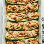 BBQ Chicken Zucchini Boats in a baking dish fresh out of the oven