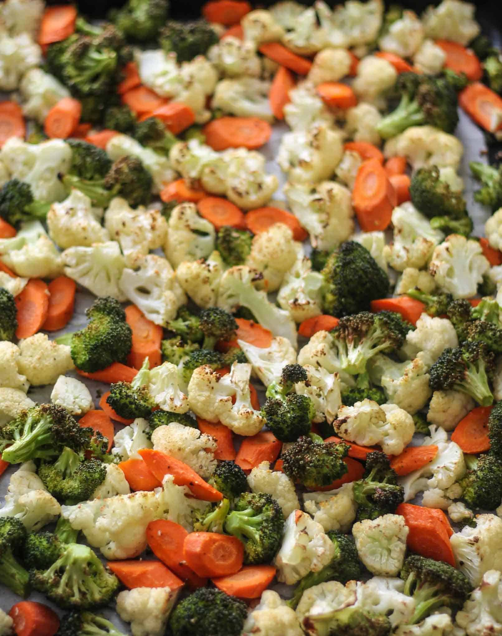 Roasted broccoli, carrots, and cauliflower on a sheet pan